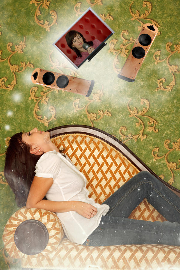 Download Girl Sits On Sofa And Dreams About Hi-fi System Stock Photo - Image: 17886916