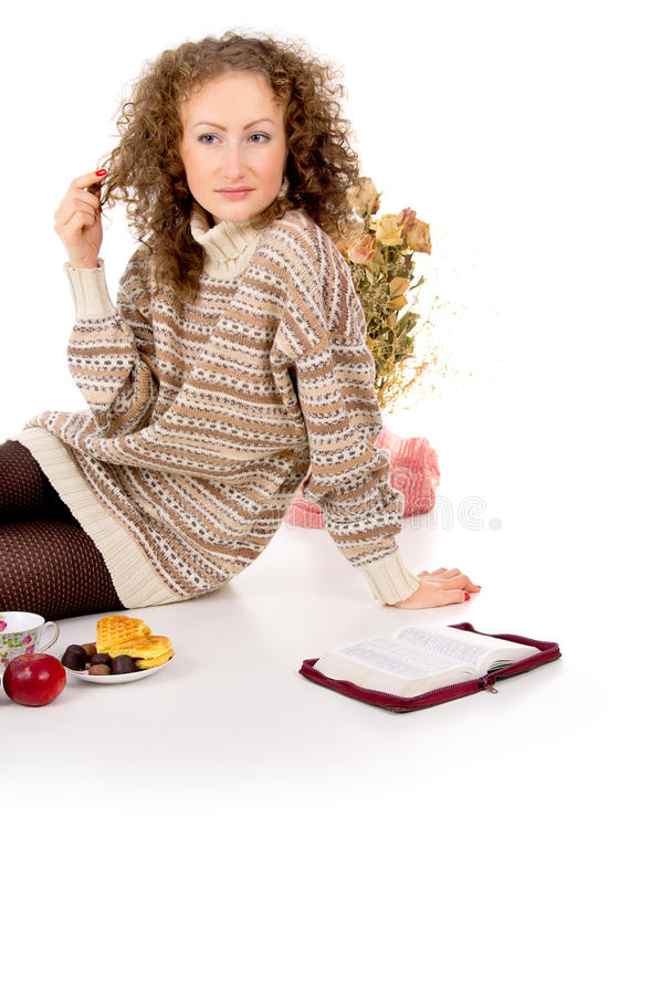 Download Girl Sits In A Sweater And A Book And Resting Stock Photo - Image: 27689746