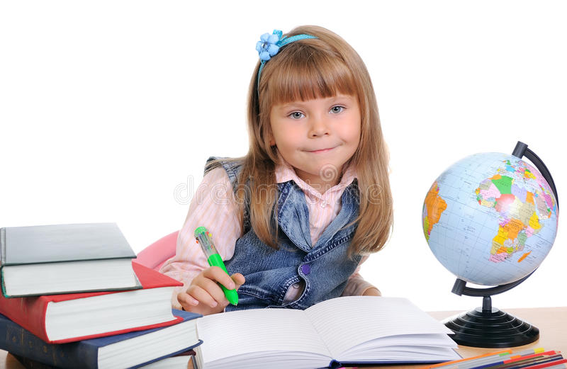 Download Girl Sits At A Table And Writes Royalty Free Stock Photos - Image: 16322148