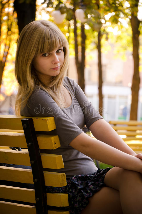 Download Girl sitting on a bench stock photo. Image of blonde - 21478238