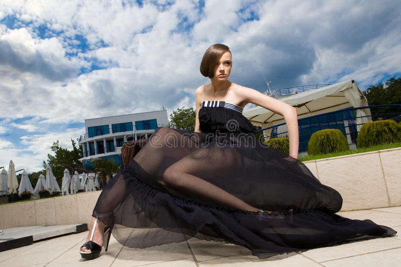 A girl sitting on the board royalty free stock photography