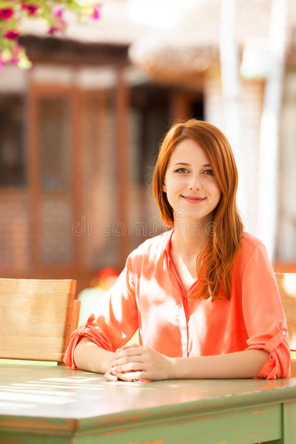 Girl Sitting In The Cafe Royalty Free Stock Photo