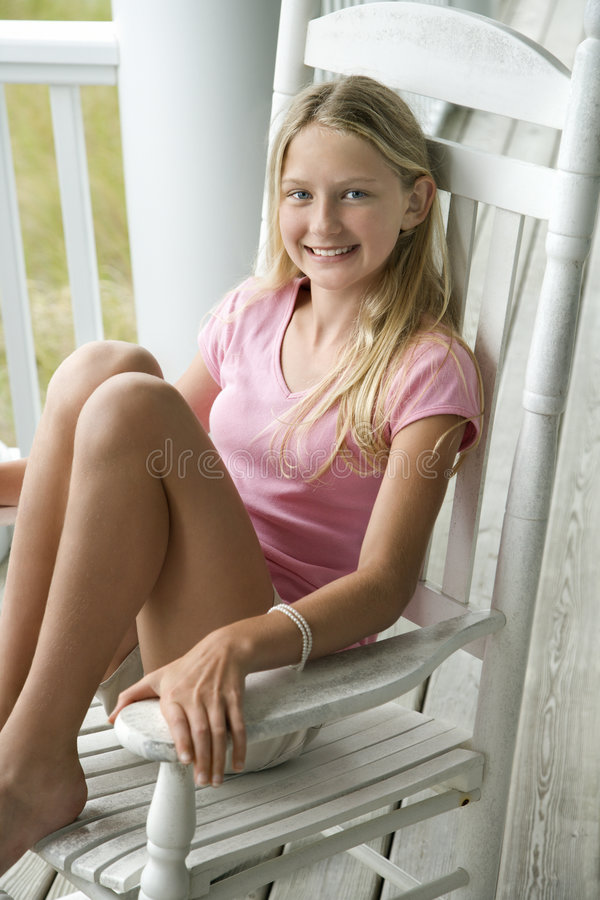 Girl sitting in chair royalty free stock images