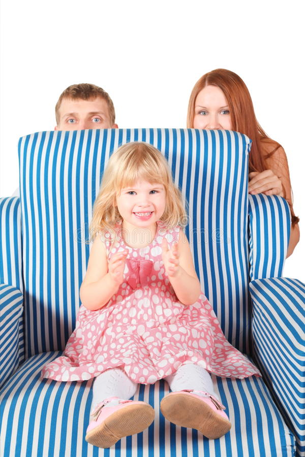 Download Girl Is Sitting On Char, Parents Behind Her Stock Image - Image: 15512287