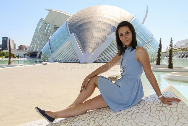 Girl is sitting in city of Arts and Sciences in Valencia. September 23, 2014 in Valencia, Spain royalty free stock image