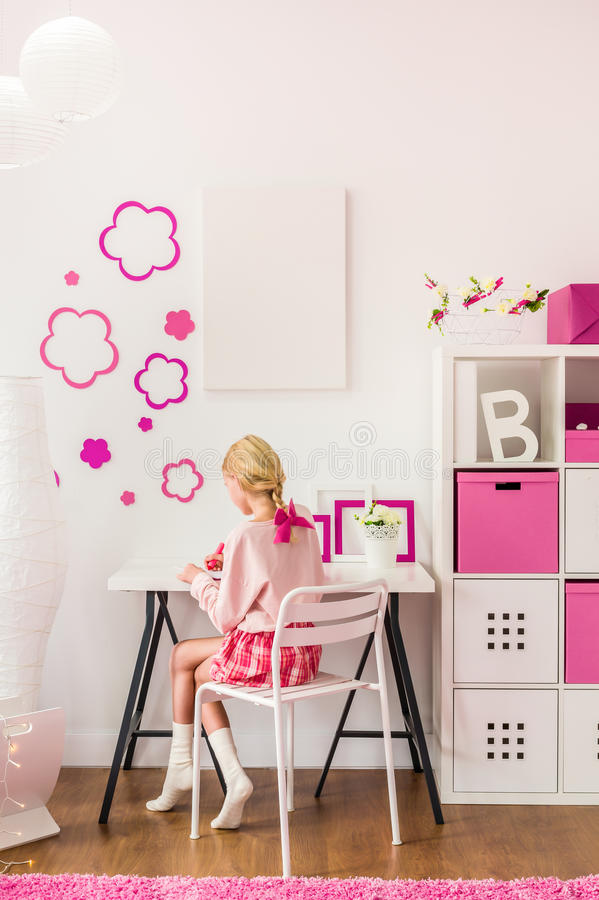 Girl sitting at the desk royalty free stock photo