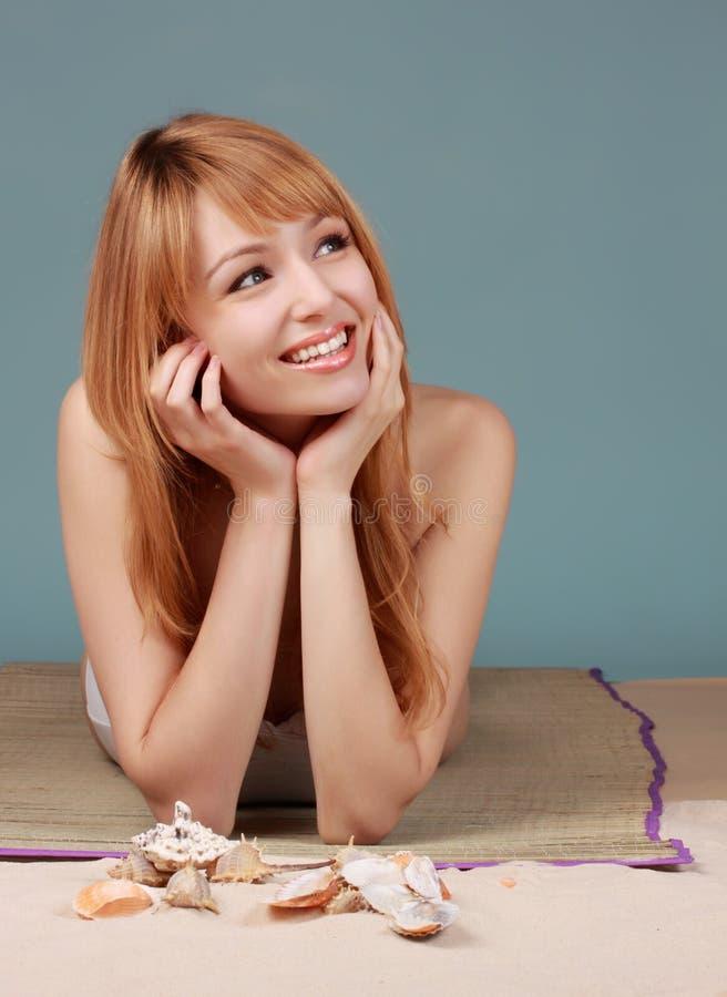 Download Girl Sitting On Fake Beach Royalty Free Stock Image - Image: 12619206