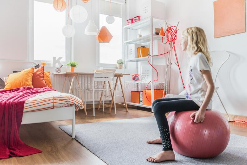 Girl sitting on fitness ball stock photo