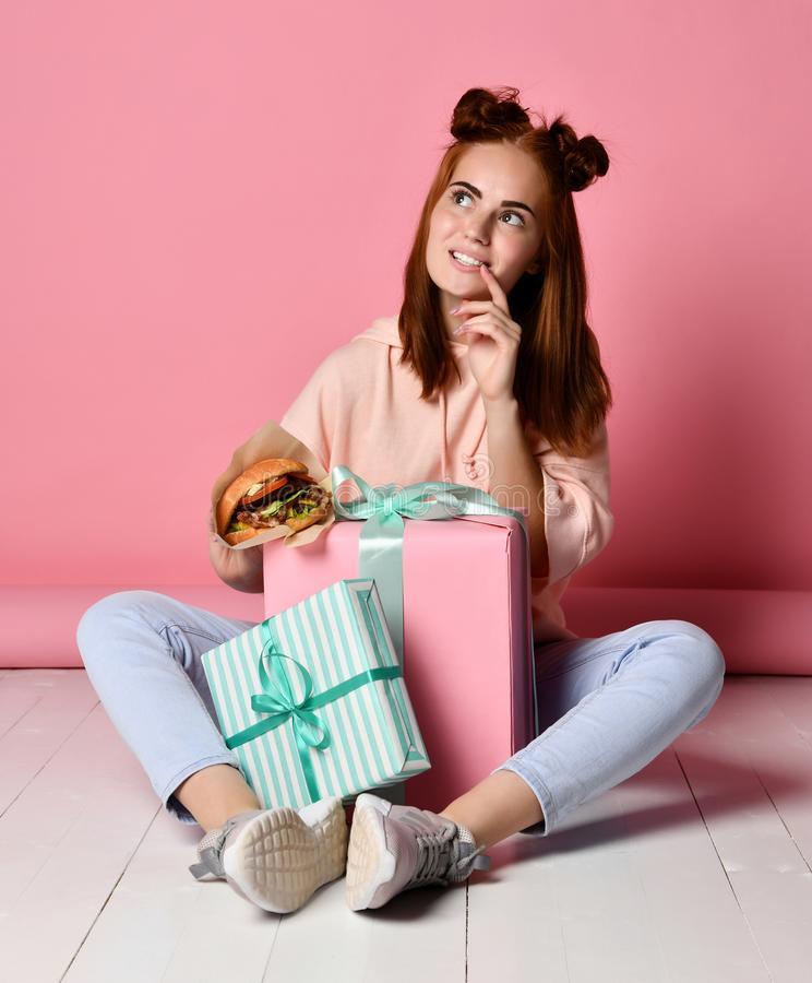 Girl sitting floor birthday gifts stock images