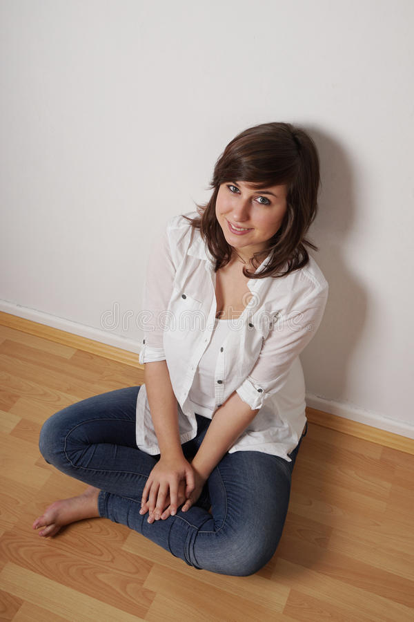Girl sitting on floor royalty free stock images