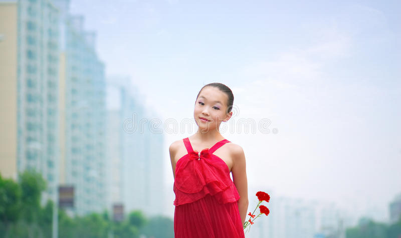 Girl sitting on the grass stock photos