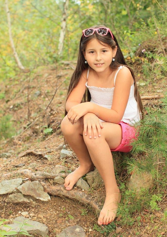 Download Girl sitting on ground stock image. Image of child, shorts - 33269651