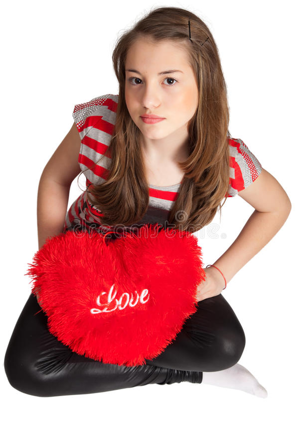 Download Girl Sitting With Heart Shaped Pillow Stock Image - Image: 19092527