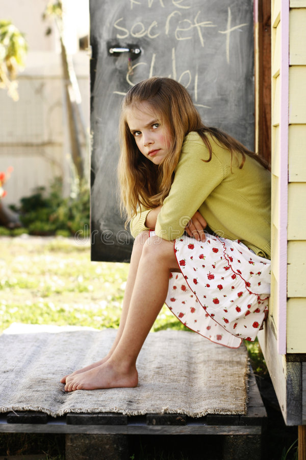 Girl Sitting Looking Angry Royalty Free Stock Image