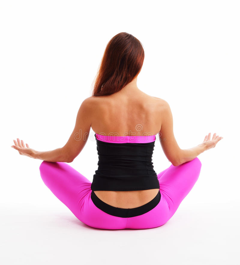 Girl sitting in the lotus position stock images