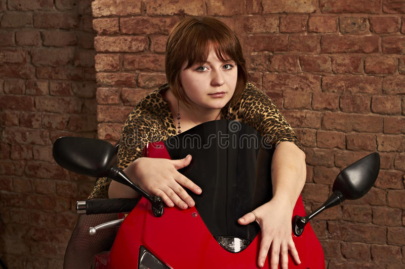 Download Girl Sitting On A Red Motorcycle Stock Image - Image: 24639203