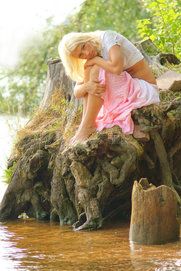 Download Girl Sitting At River Bank With Head On Her Knees Stock Image - Image: 15723443