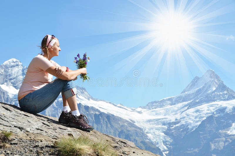 Girl sitting on a rock royalty free stock images