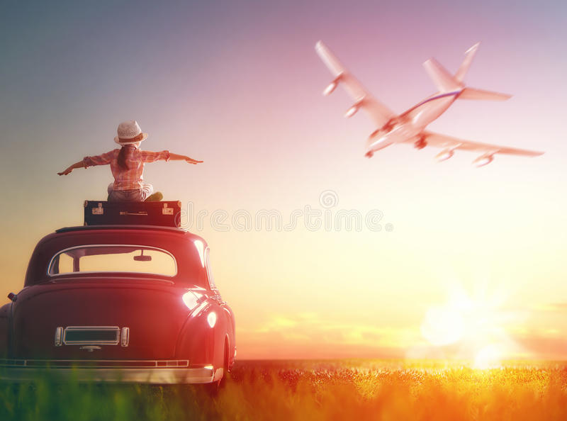 Girl sitting on roof of car. stock photos
