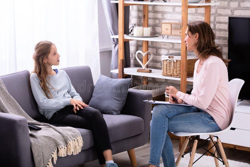 Girl Explaining Her Problems To Psychiatrist stock photography