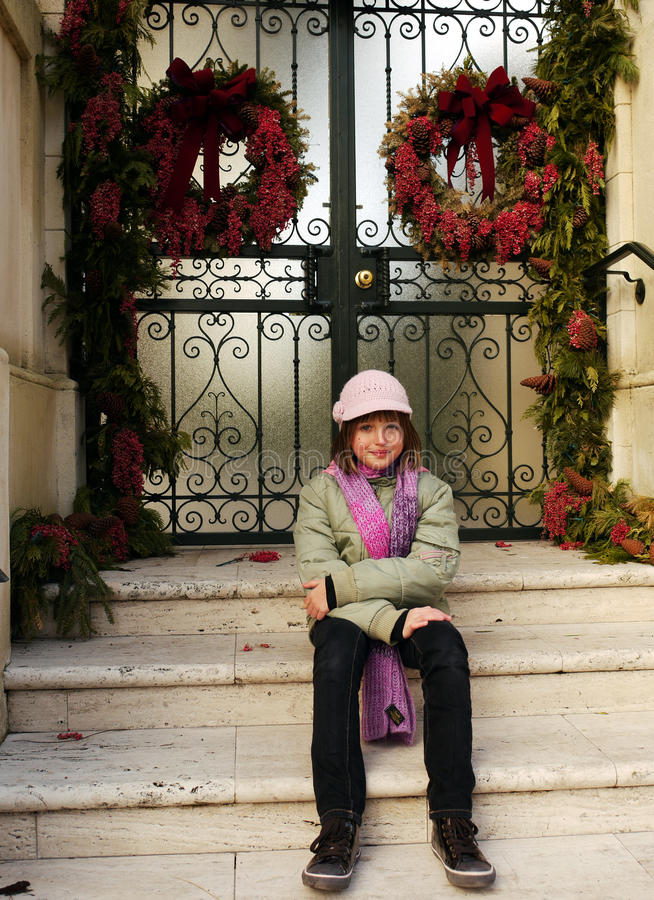 Girl Sitting On Stairs Royalty Free Stock Photos