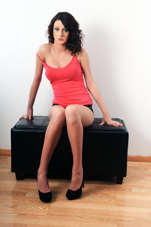 Girl Sitting on a Stool stock photography
