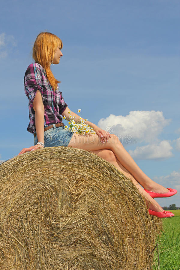 Download Girl sitting on straw bale stock photo. Image of girl - 26243108