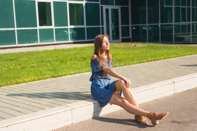 Girl sitting on street in summer day.  royalty free stock photo