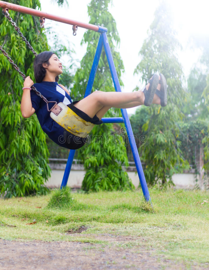 Girl Sitting Swing. royalty free stock image