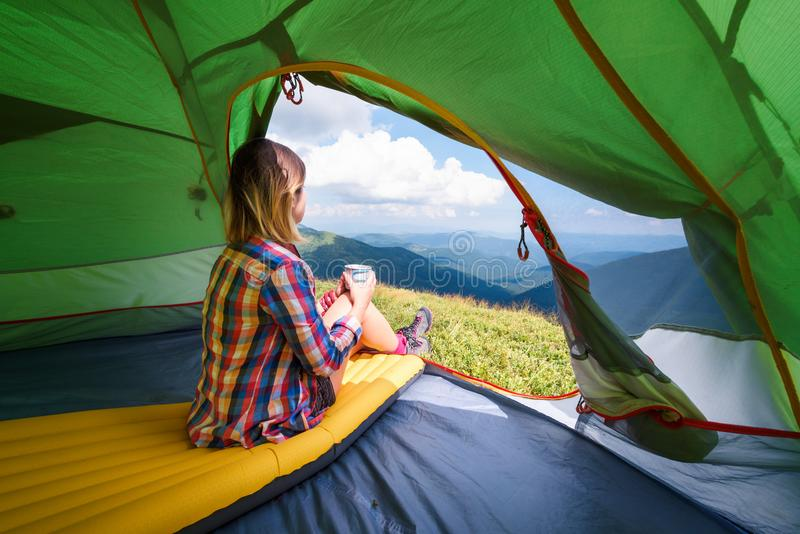 Girl sitting in they tent royalty free stock photo