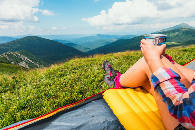 Girl sitting in they tent stock photo