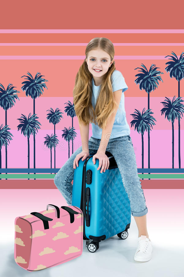 Girl sitting on traveling bag royalty free stock photo