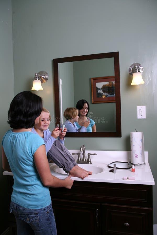 Download Girl Sitting On Vanity With Older Teen Stock Photo - Image: 6555726