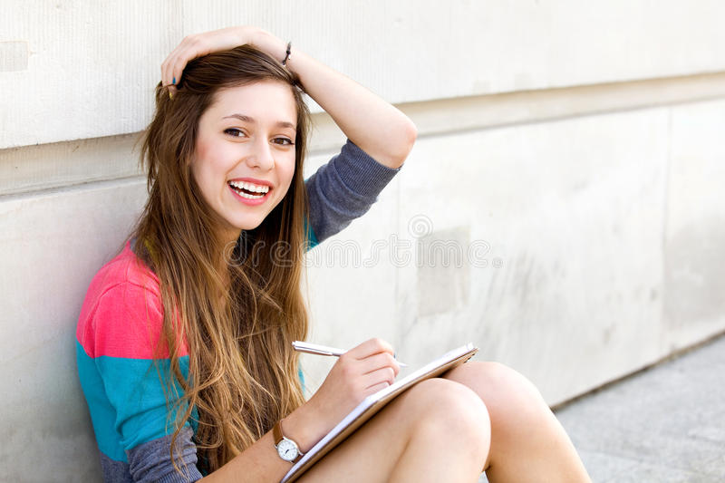 Girl Sitting By The Wall Royalty Free Stock Images