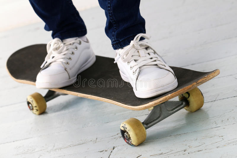 Girl on the skateboard. Shoes, sport. Teenager with skateboard royalty free stock photos