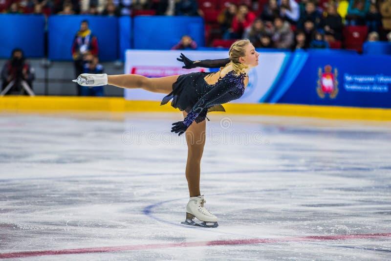 Girl skater performance in short program royalty free stock image