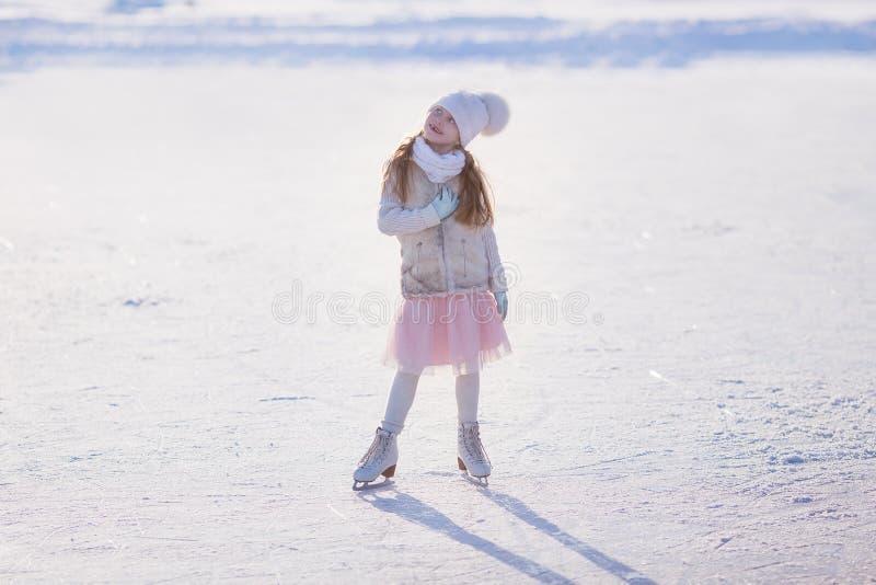 Girl skating rink stock images
