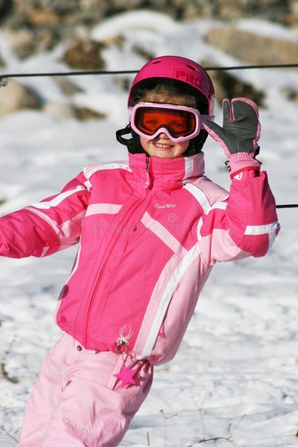Girl ski skiing smiling winter snow rest vocation pink children kid trip travel stock photo