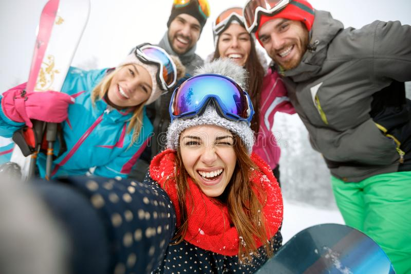 Girl on skiing with group of friends stock images