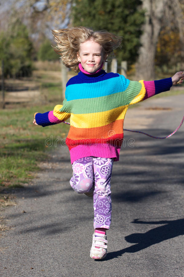 Girl skipping stock images