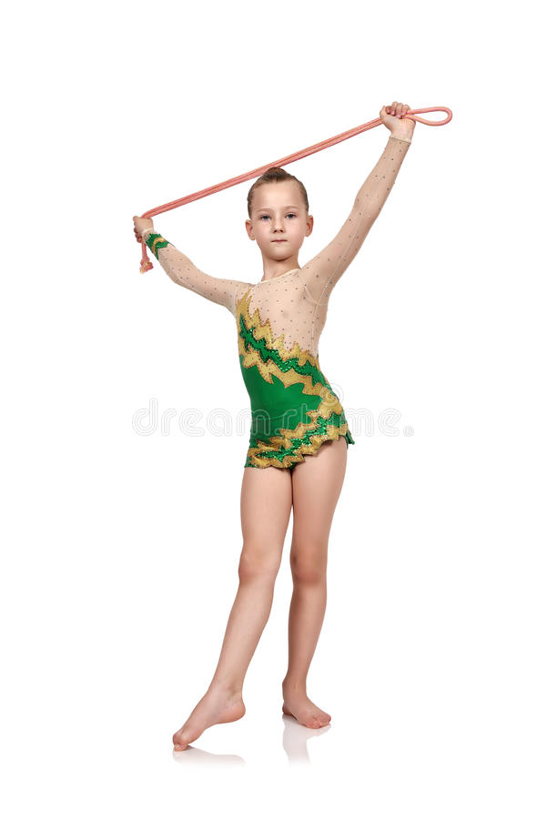 Girl with skipping rope doing gymnastics stock photo