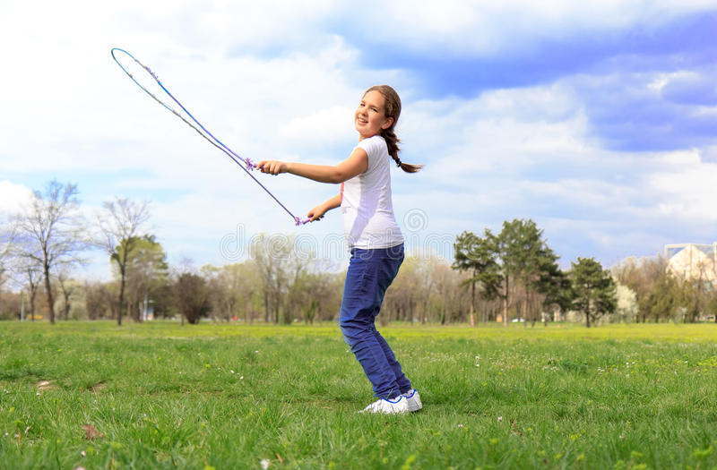 Girl with skipping rope stock photo