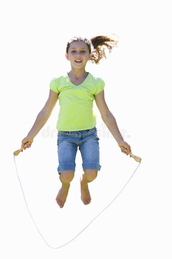 Girl skipping rope, smiling, front view, portrait, cut out stock images