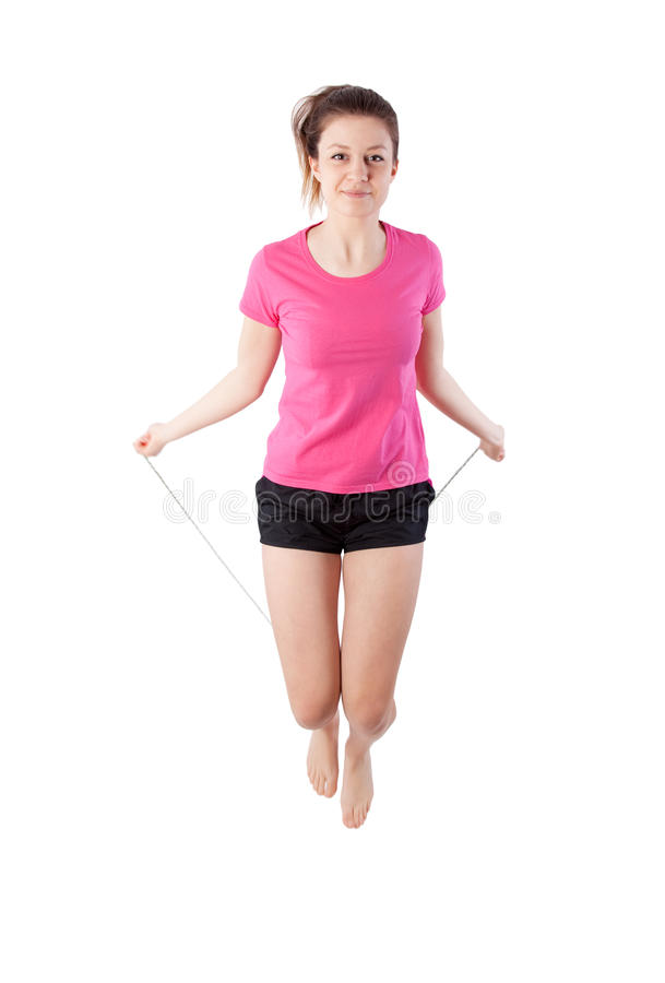 Girl with skipping rope. Young woman with a skipping rope stock photo