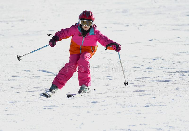 Girl on skis in soft snow on a sunny day stock photography