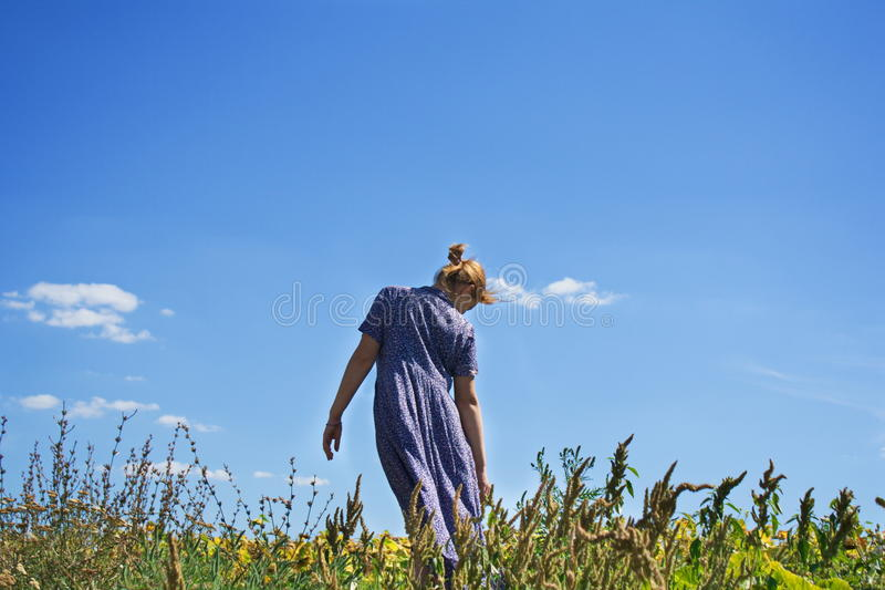 Girl and the sky stock photography