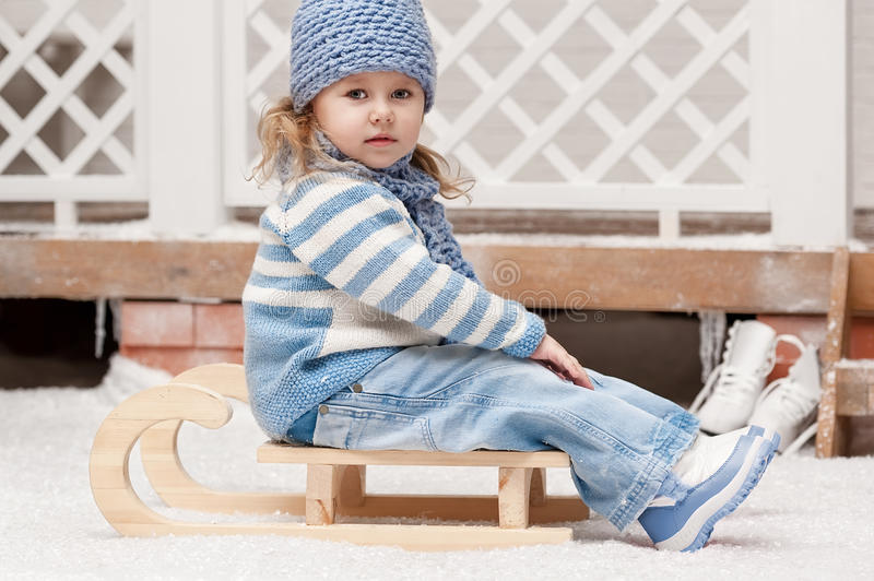 Download Girl on a sled stock photo. Image of portrait, brown - 35088486