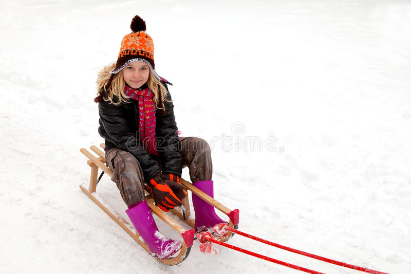 Download Girl On Sled In The Snow Royalty Free Stock Photos - Image: 22203708