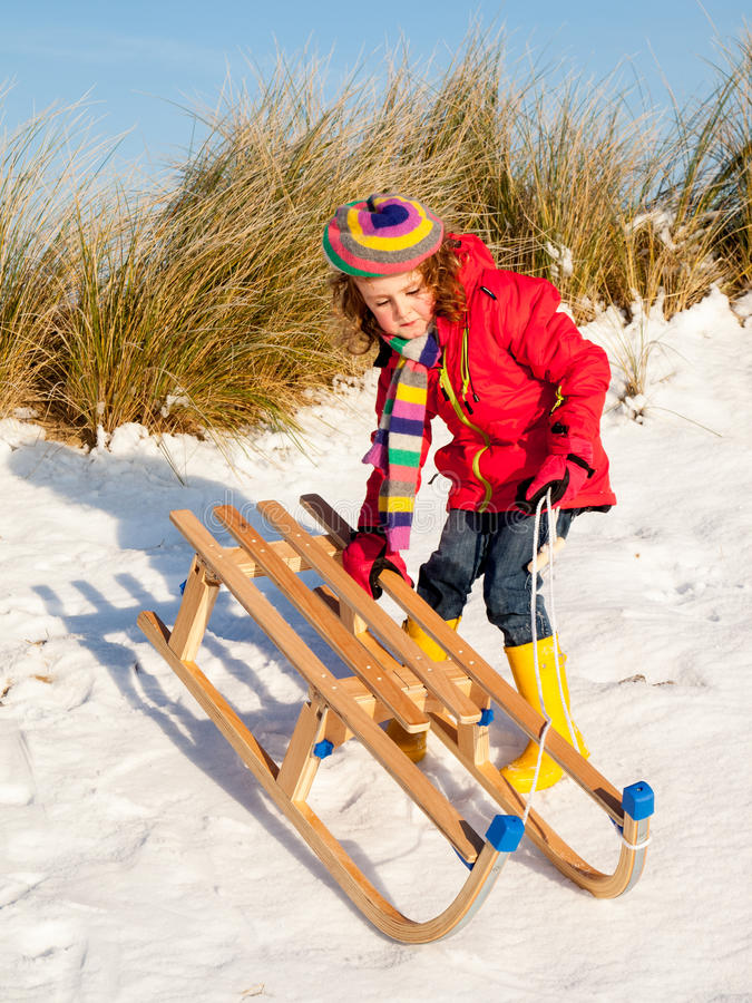 Girl with a sledge royalty free stock image