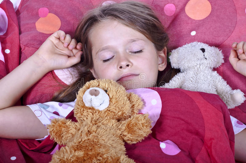 Girl sleeping in bed stock photo